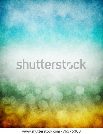 Fog, mist, and clouds with a yellow to blue gradient and boken effects.  Image has a pleasing paper texture and grain pattern visible at 100%. - stock photo