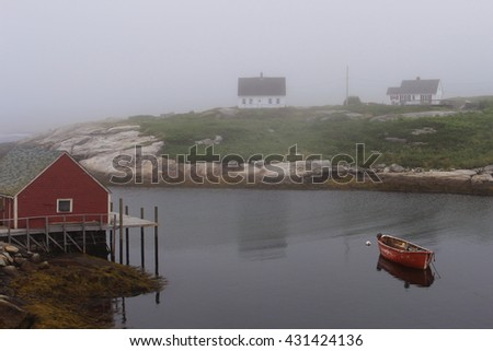 Fog over a fishing cove - stock photo