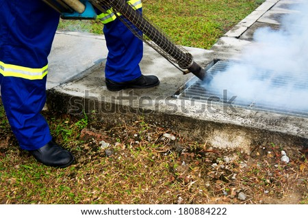 Fogging by the public health for dengue control - stock photo
