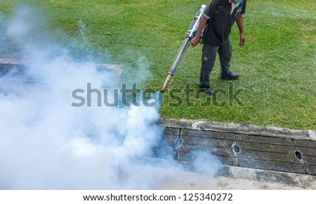 Fogging into the drain to prevent spread of dengue fever - in soft motion blur
