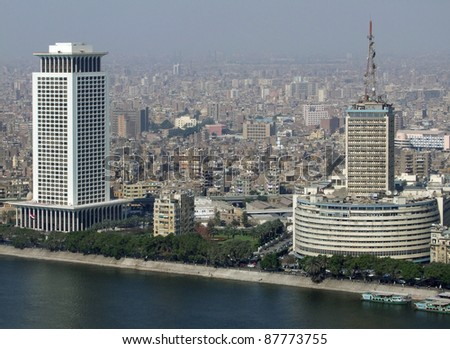 foggy aerial view of Cairo in Egypt including river Nile - stock photo