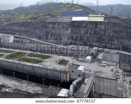 foggy aerial view of the Three Gorges Dam at Yangtze River in China - stock photo