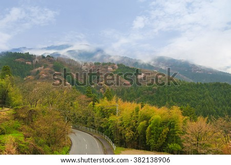 Foggy afternoon view of the road surrounded by beautiful mountain and nature during Spring in Magome - juku, Japan