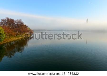 Foggy Cherry Blossom and Washington Monument, Washington DC, United States - stock photo