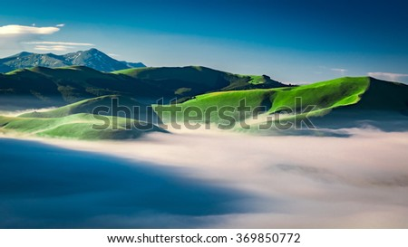 Foggy dawn in the Castelluccio, Umbria, Italy - stock photo