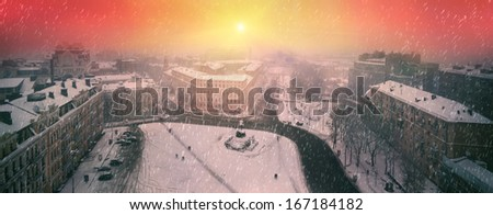 Foggy evening view from the bell tower of St. Sophia Orthodox monastery opens a panorama, the paths of which are single figures of passers-people, Beautiful sunrise over St. Michael's Monastery  - stock photo