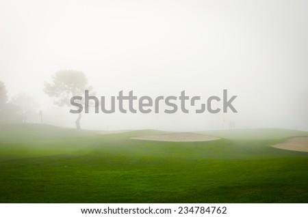 Foggy Fairway - stock photo