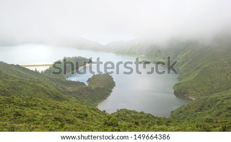Foggy lake in a volcanic crater in the Azores - stock photo