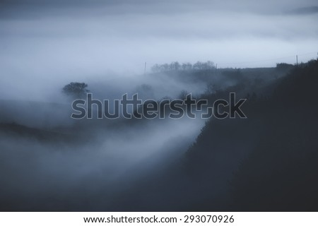 foggy landscape in morning - stock photo