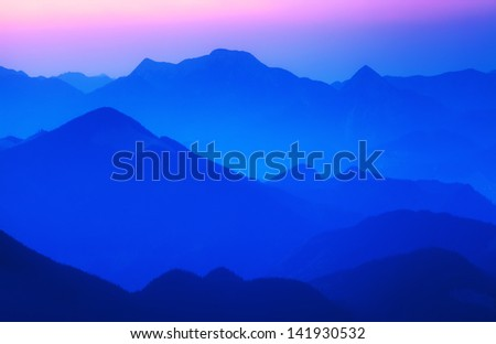 Foggy landscape in mountains as background - stock photo