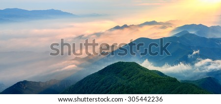 Foggy landscape in the mountains.Fantastic morning glowing by sunlight. - stock photo