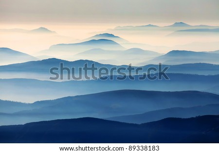 Foggy landscape in the Romanian Carpathians - stock photo