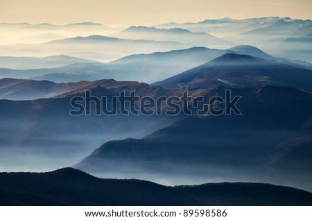 Foggy landscape in the Romanian Carpathians - stock photo