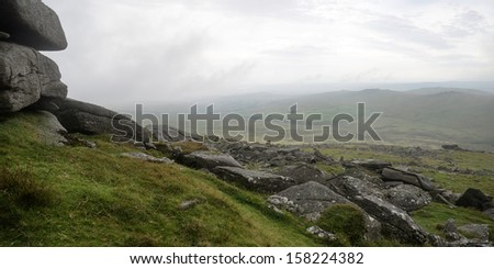 Foggy landscape over Dartmoor National Park with rocky detail