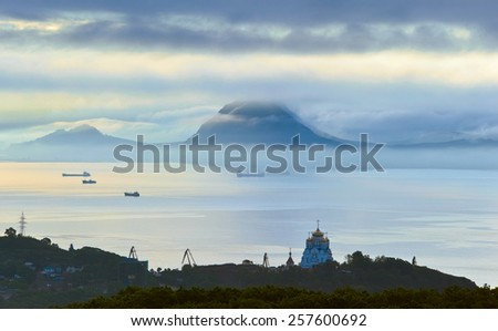 Foggy morning in the city on the bay. - stock photo