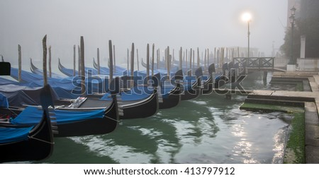Foggy morning in Venice. Dock for gondola on the Grand Canal in Venice