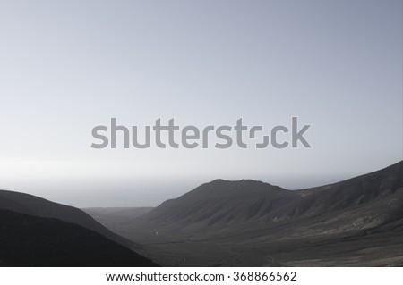 foggy mountain at sunrise - stock photo