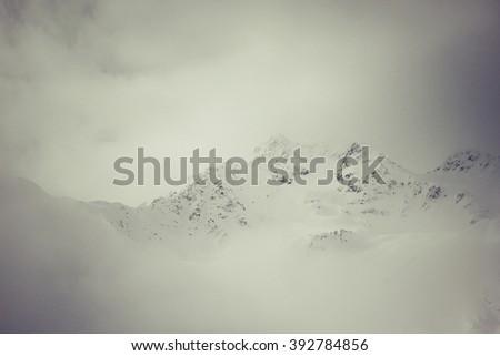 foggy mountain in Val Senales, Italy - stock photo