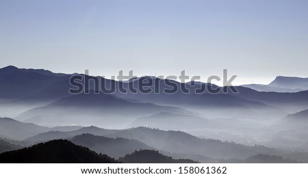 Foggy mountains - stock photo