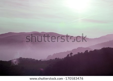 Foggy mountains in a winter morning - stock photo