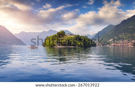 Foggy spring morning on the island Comacina on Lake Como. Alps, Italy. - stock photo