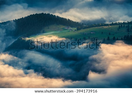 Foggy summer scene in the Dolomite Alps. Ranch at the foot of Furchetta peak. Province of Bolzano, South Tyrol, Italy, Europe. - stock photo
