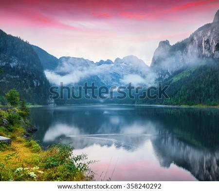 Foggy summer scene on the Vorderer Gosausee lake in the Austrian Alps. Austria, Europe. - stock photo