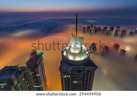 Foggy sunrise in Dubai  - stock photo