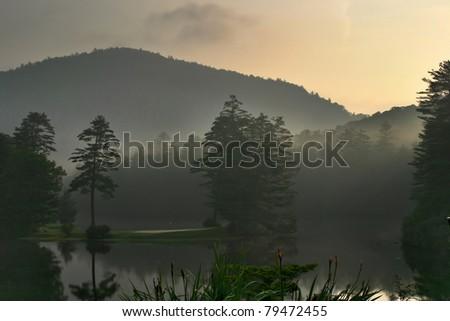 Foggy Sunrise on Mountain Lake, near Cashiers, North Carolina - stock photo