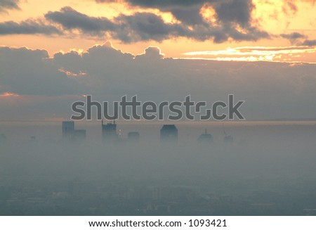 Foggy sunrise over brisbane city - stock photo