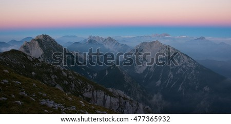 Foggy sunset in the mountains in Julian Alps