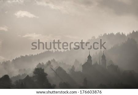 Foggy town landscape - stock photo