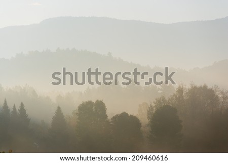 Foggy tree covered mountain ranges, Stowe, Vermont, USA - stock photo