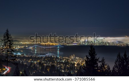 Foggy Vancouver night, looking down at Lions Gate Bridge and Downtown from the Lookout