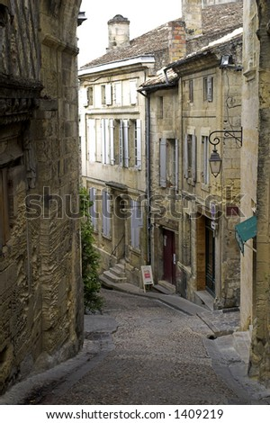 Foggy view looking down an alley of the city of St. Emilion, near Bordeaux, France.  A world heritage site. - stock photo