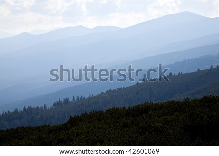 foggy view of rila mountains hills during summer