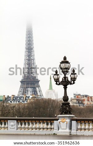 Foggy view on the Eiffel tower in the mist in Paris in winter