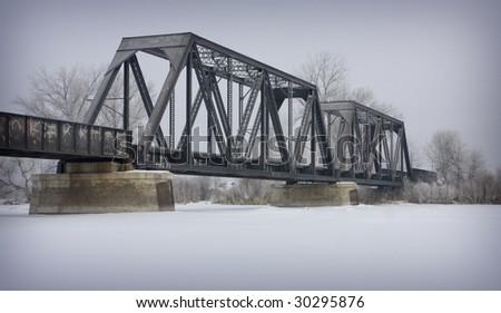 Foggy winter train bridge on the Snake River, Blackfoot Idaho - stock photo