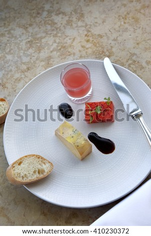 Foie gras, watermelon and juice, toast on a plate