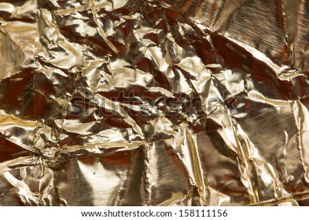 foil background with orange flavor - stock photo