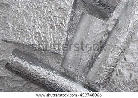 Foil figures with shiny crumpled surface. Contemporary art