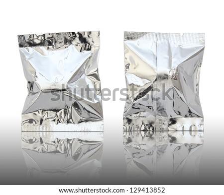 Foil package on reflect floor and white background - stock photo