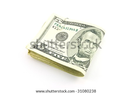 Fold of single dollar bills with paper clip on a white background