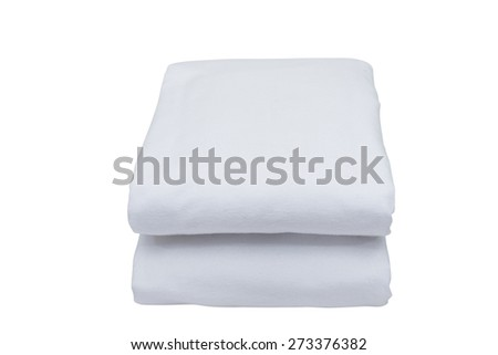 Folded bedding sheets on white