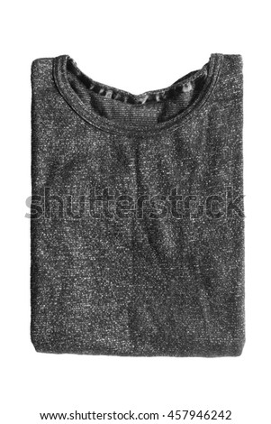 Folded black sweatshirt on white background