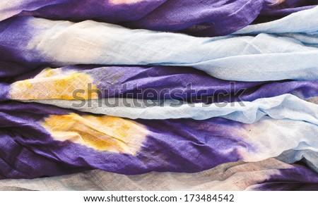 Folded blue and yellow Mauritanian cotton as a background image - stock photo