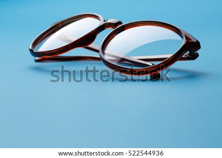 Folded brown spectacles close up
