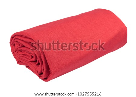 Folded fabric isolated on white background. Selective focus.