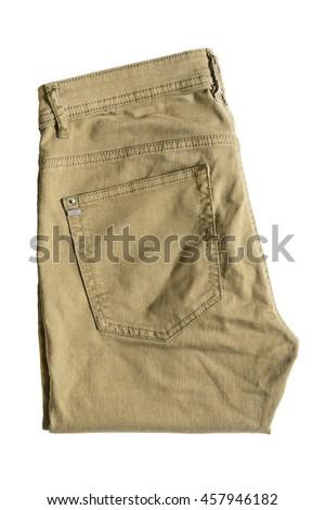 Folded khaki pants isolated over white - stock photo