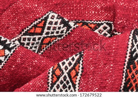 Folded kilim Moroccan rug as a background image - stock photo